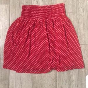 Red mini skirt.